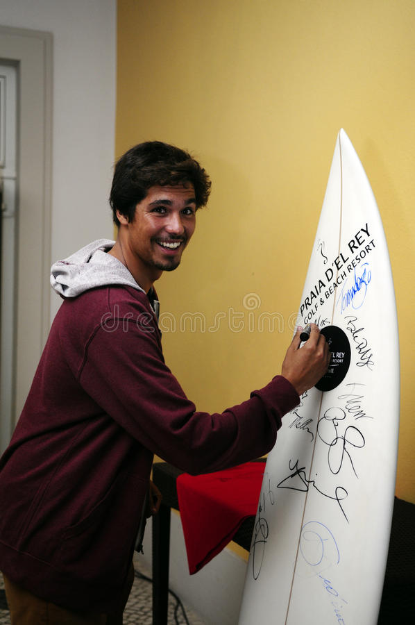 Francisco Alves, RIP Curl Pro Portugal 2013. Professional portuguese Surfer Francisco Alves signing a surfboard at dinner hosted by the Marriott Hotel in Praia D stock images