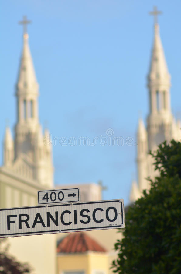 Francisco street sign against the bells towers of Saints Peter a. Nd Paul Church in San Francisco California royalty free stock photography