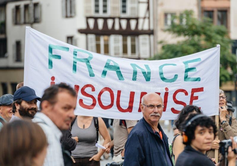 Francja insoumise plakat przy protestem przeciw Macron obrazy royalty free