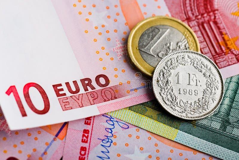 Franco suíço contra o euro fotografia de stock