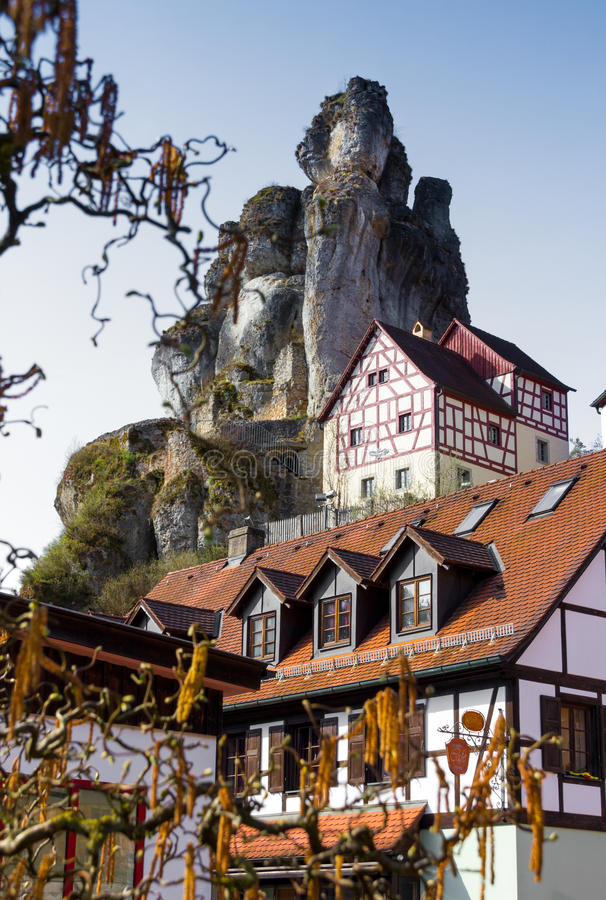 Rock formations with houses Franconian Switzerland Germany. Bizarre columns of limestone, half-timbered houses, Franconian Switzerland Museum Pottenstein stock images