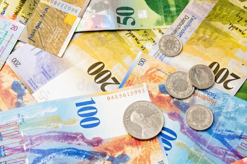 Francos suíços da moeda fotografia de stock