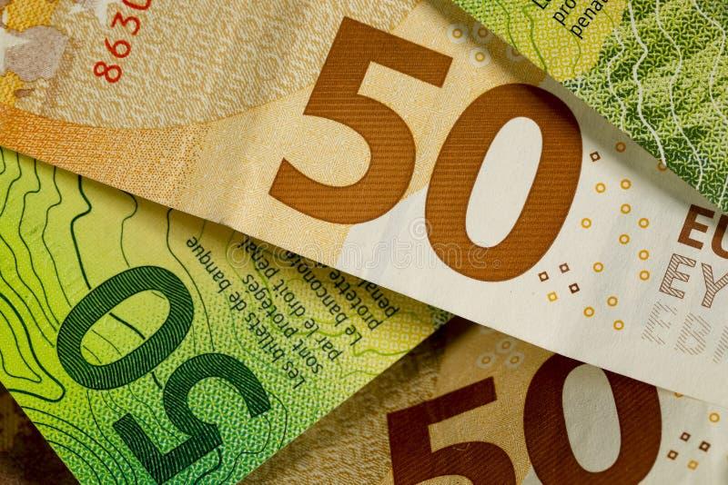 Francos suíços e o euro- dinheiro imagem de stock