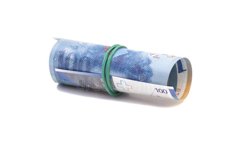 Francs suisses dans un petit pain image stock