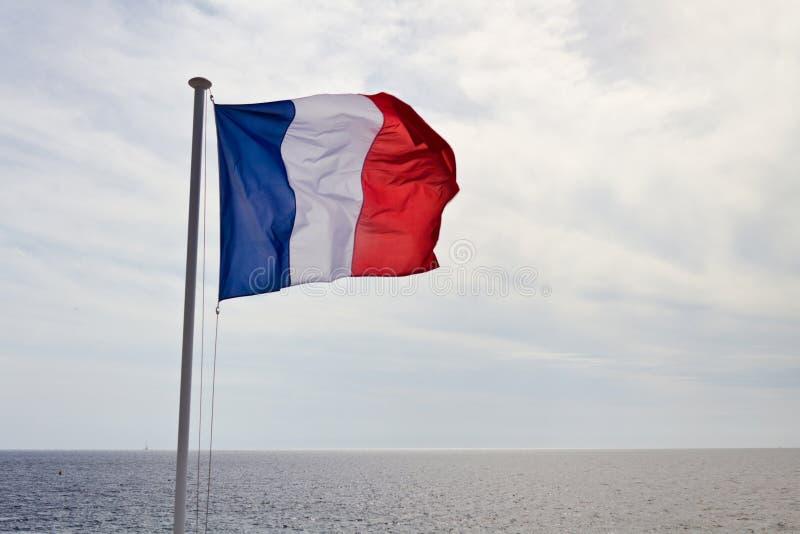 Francuza chorągwiany falowanie w wiatrze obrazy stock