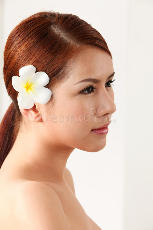 Free Frangipani In Her Ear Royalty Free Stock Image - 48739756