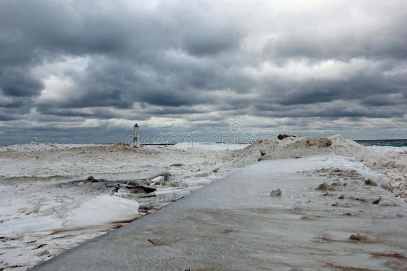 Frankfort Lighthouse. Picture of the Frankfort Lighthouse in the Winter. The Frankfort Lighthouse is on Lake Michigan stock photos