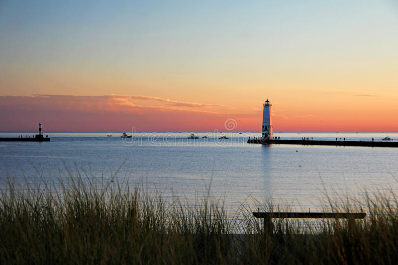 Frankfort michigan lighthouse at sunset stock photo for Michigan fishing license prices