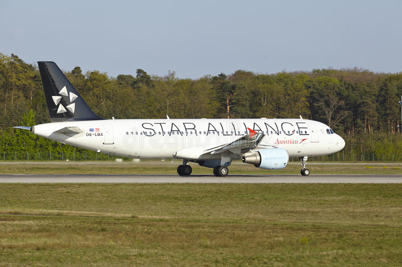 Frankfurt Airport - Airbus A320-214 of Austrian Airlines takes off. An Airbus A320-214 in Star Alliance finish of Austrian Airlines takes off at Frankfurt royalty free stock photography