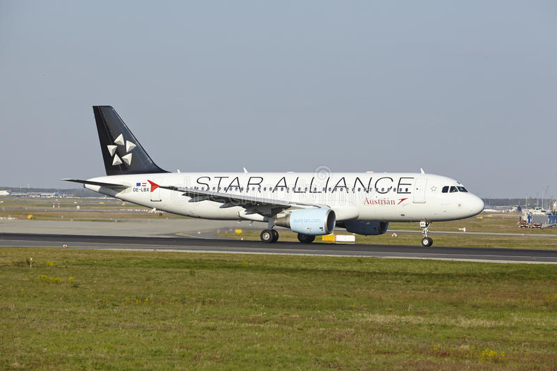 Frankfurt Airport - Airbus A320-214 of Austrian Airlines takes off. An Airbus A320-214 in Star Alliance finish of Austrian Airlines takes off at Frankfurt stock photos