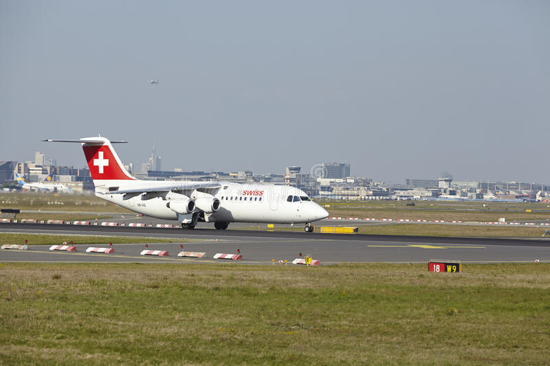 Frankfurt Airport - Avro RJ100 of Swiss International Air Lines takes off royalty free stock photography