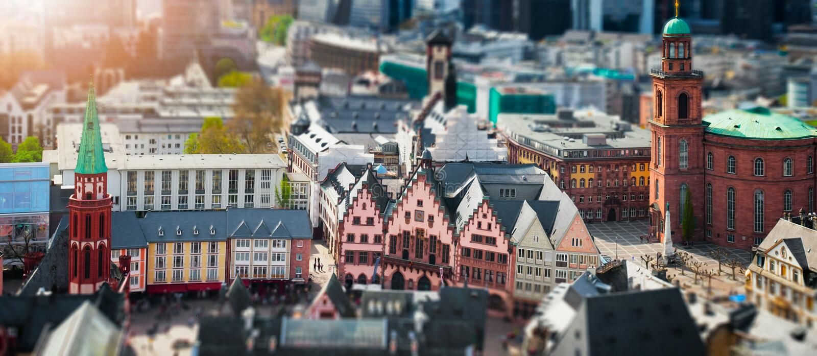 Frankfurt, Germany aerial view panorama with sunlight. City center with city hall and church. Tilt shift blur effect royalty free stock images