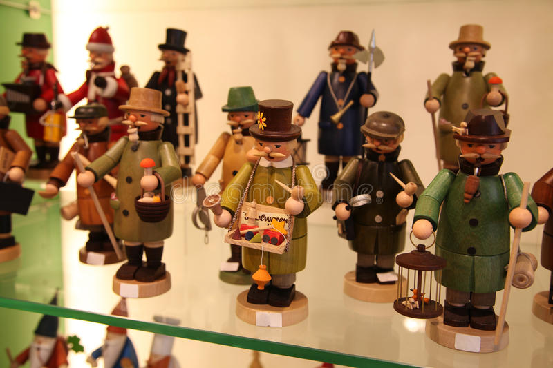 FRANKFURT, GERMANY - APRIL 18, 2013: German wooden toys: figurines depicting profession royalty free stock photo