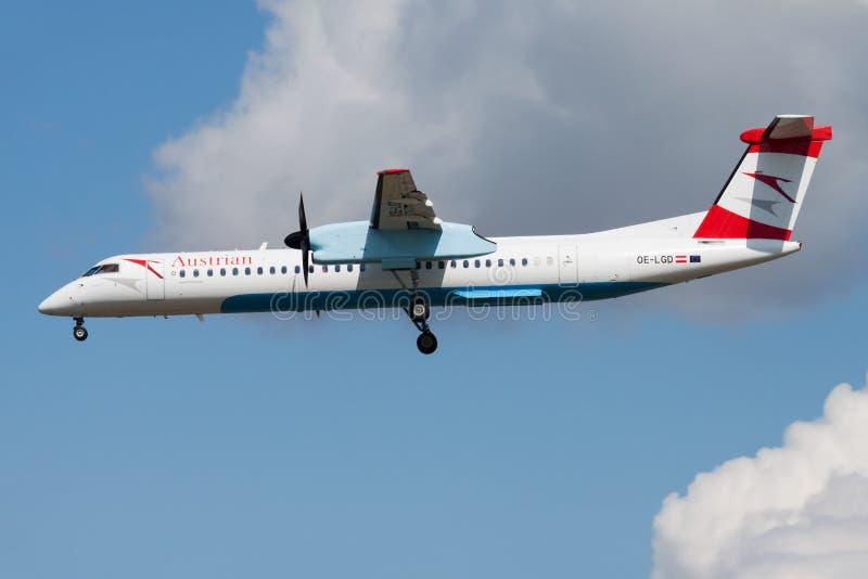 Austrian Airlines Bombardier DHC-8 Q400 OE-LGD passenger plane landing at Frankfurt airport stock photos