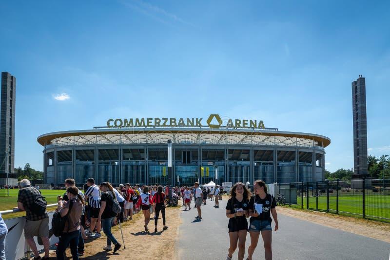Commerzbank Arena and football fans - home stadium of football club Eintracht Frankfurt. Frankfurt, Germany- July 2019: View of Commerzbank Arena and football royalty free stock photos