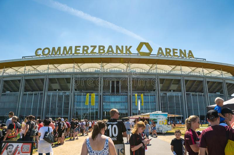 Commerzbank Arena and football fans - home stadium of football club Eintracht Frankfurt. Frankfurt, Germany- July 2019: View of Commerzbank Arena and football royalty free stock photography