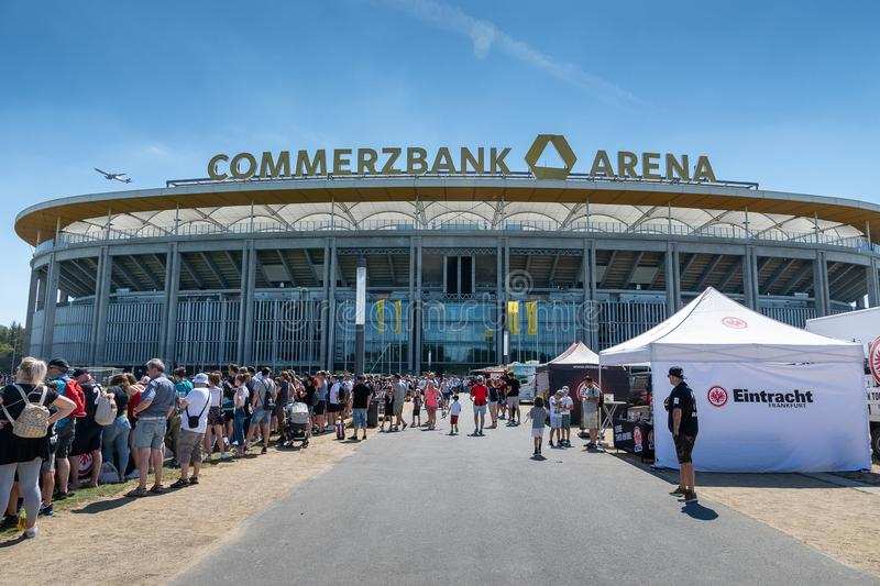 Commerzbank Arena and football fans - home stadium of football club Eintracht Frankfurt. Frankfurt, Germany- July 2019: View of Commerzbank Arena and football royalty free stock image