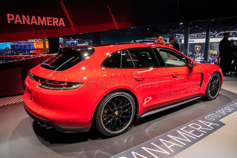 FRANKFURT, GERMANY - SEP 10, 2019: Porsche Panamera GTS Sport Turismo sports car showcased at the Frankfurt IAA Motor Show 2019. Red new modern model auto stock image