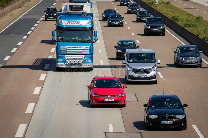 German highway traffic. FRANKFURT, GERMANY - SEP 11, 2019: Traffic on a German highway. German autobahns have no general speedlimit and rank as the fifth longest royalty free stock image