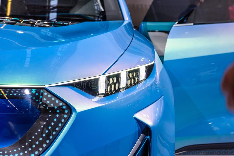 FRANKFURT, GERMANY - SEPT 2019: headlight sky blue Great Wall Motors WEY-X Concept electric SUV Car, IAA International Motor Show royalty free stock photography