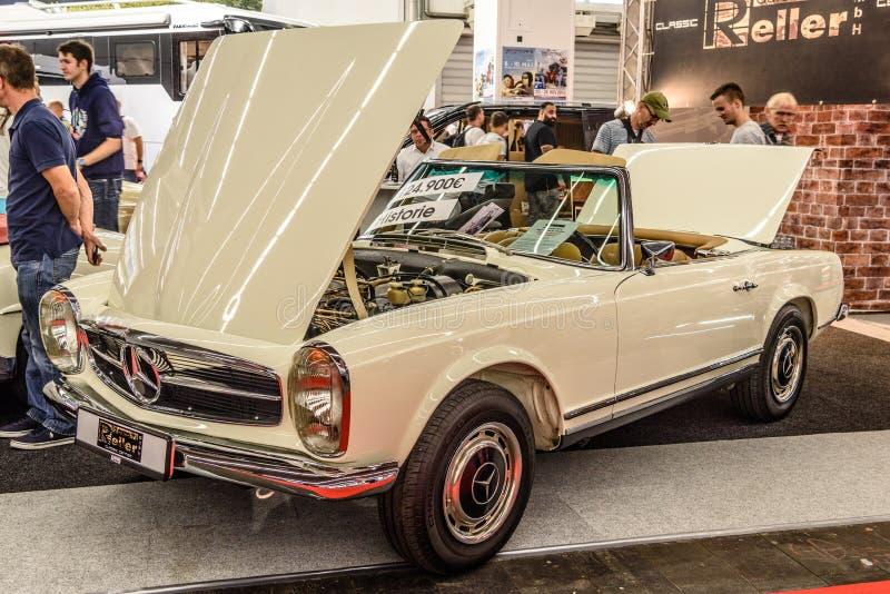 FRANKFURT, GERMANY - SEPT 2019: white ivory MERCEDES 280 SL W113 cabrio roadster 1963 1971 with opened hood, IAA International stock photo