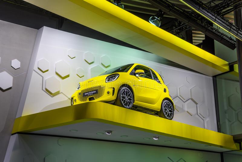 FRANKFURT, GERMANY - SEPT 2019: yellow SMART EQ FORTWO small electric car from MERCEDES-BENZ, IAA International Motor Show Auto stock image