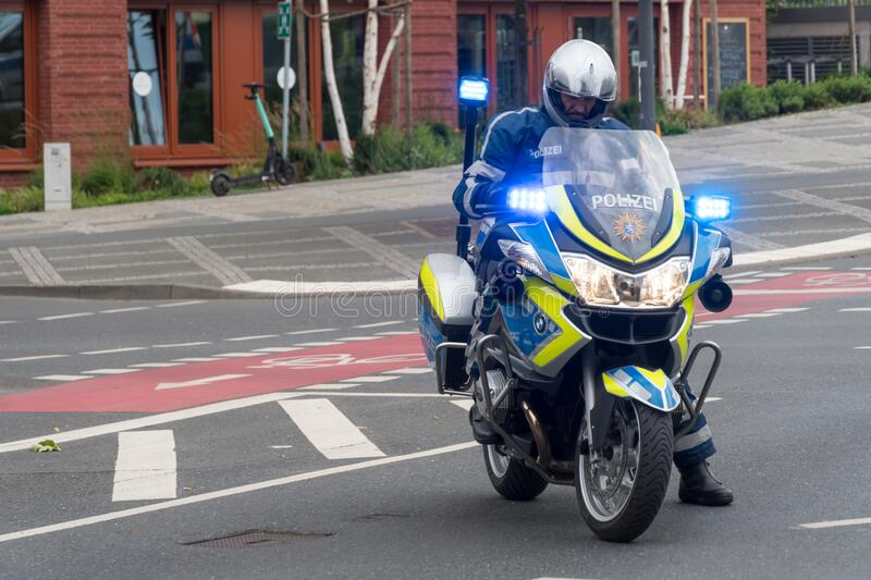 German police officer on motorcycle stock image