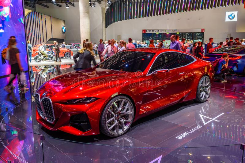 FRANKFURT, NIEMCY - WRZESIEŃ 2019 R.: Red BMW CONCEPT 4 M NEXT VISION Electrical coupe car, IAA International Motor Show Auto Exh zdjęcia royalty free