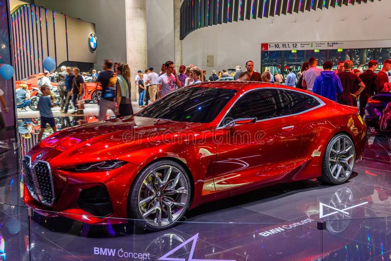 FRANKFURT, NIEMCY - WRZESIEŃ 2019 R.: Red BMW CONCEPT 4 M NEXT VISION Electrical coupe car, IAA International Motor Show Auto Exh fotografia stock
