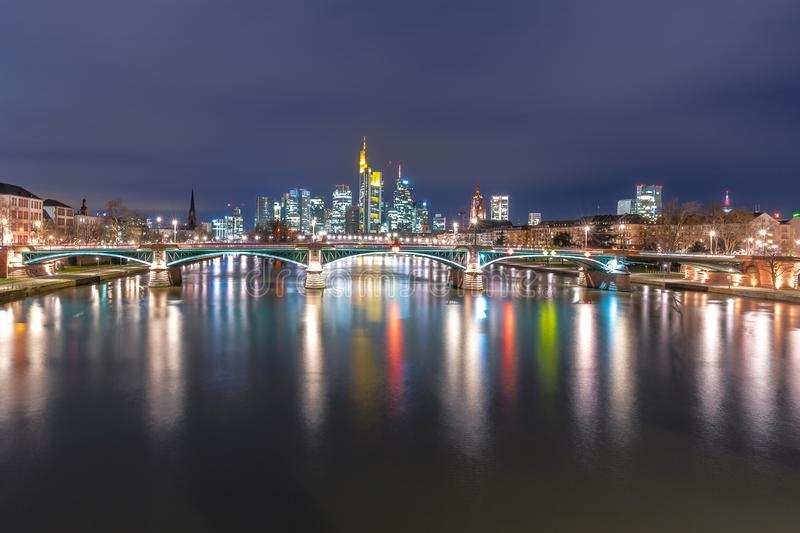 Cityscape with skyline, Financial District and Main river at night, Frankfurt Germany royalty free stock images