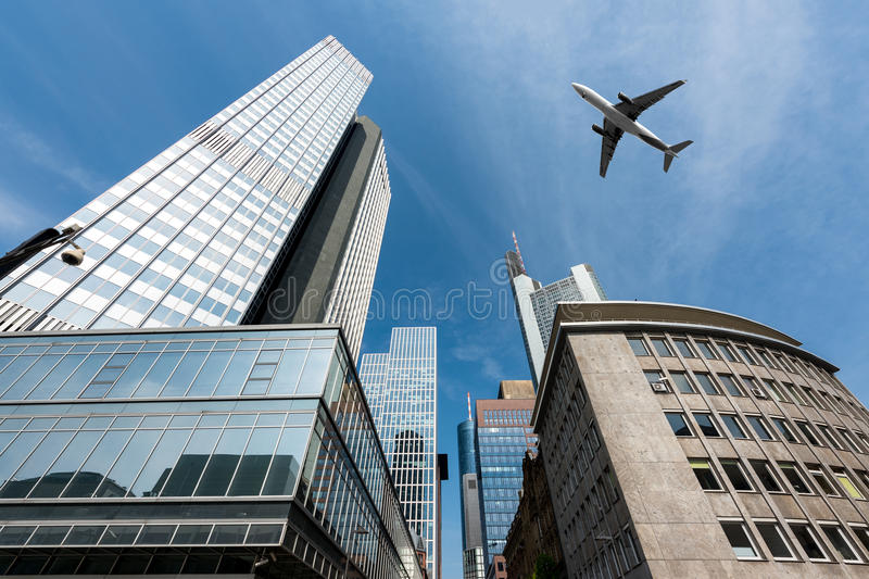 Frankfurt skyscrapers buildings and a plane flying overhead in m stock photo