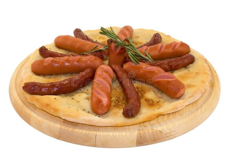 frankfurters зажгли горячие сосиски pita стоковое фото rf