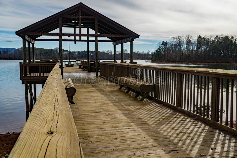 View of a Fishing Pier – Smith Mountain Lake, Virginia, USA. Franklin County, VA – January 9th: An abstract view of the fishing pier located at royalty free stock photo