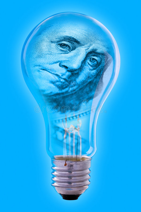 Franklin face and light bulb. A closeup of a light bulb with the face of Benjamin Franklin from a US dollar bill showing through the glass, on a blue background stock photo
