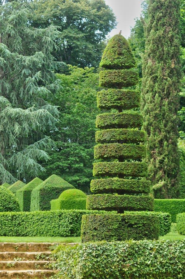 Frankrike pittoreska Jardins du Manoir D Eyrignac i Dordogne fotografering för bildbyråer