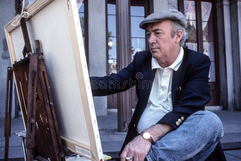 Frans Kwart, New Orleans, Louisiane, - de kunstenaar van de circa hetmannelijke straat schilderen op canvas in Jackson Square royalty-vrije stock fotografie