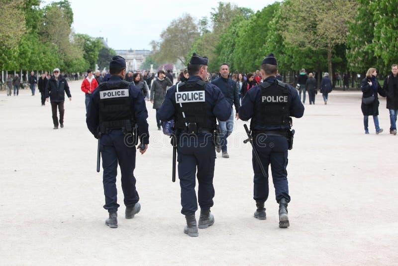 Franse politiecontrole de straat stock foto's
