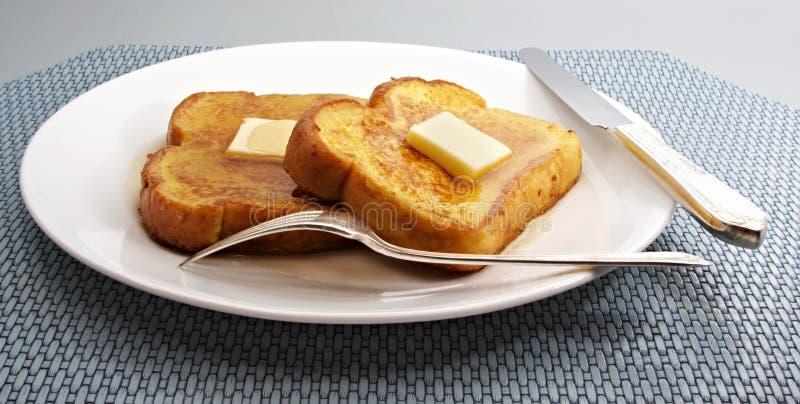 Franse toost met boter royalty-vrije stock afbeelding