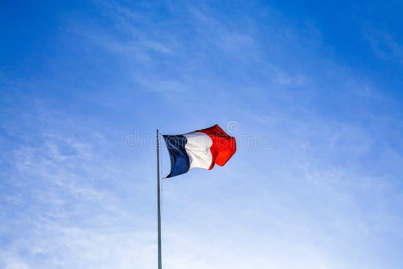 Franse vlag die de wind in Parijs, Frankrijk golven royalty-vrije stock foto