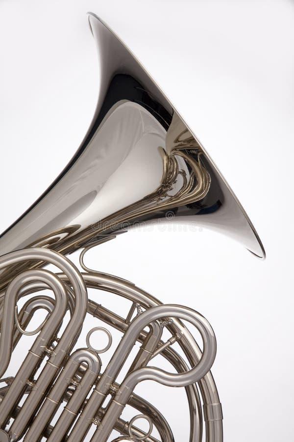 fransk horn isolerad silverwhite arkivfoto