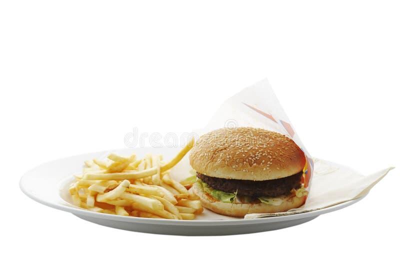 fransmannen steker hamburgaren fotografering för bildbyråer