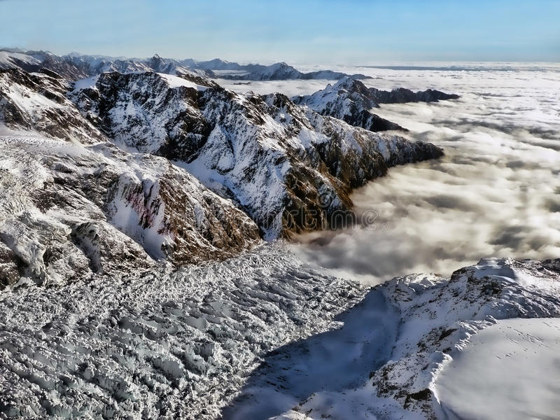 Franz Josef Glacier and surrounding mountains royalty free stock image