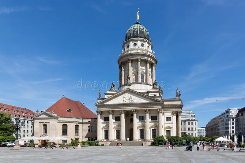 Franzosische Dom and Church in Berlin. BERLIN, GERMANY - JULY 24: Franzosische Dom and Church with admiring tourists at the Gendarmenmarkt in the center of the stock images
