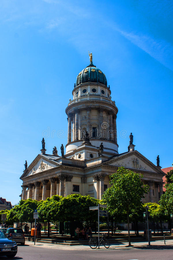 Franzosischer Dom in Berlin. BERLIN, GERMANY - JUNE 7: Franzosischer Dom and Church with admiring tourists at the Gendarmenmarkt in the center of the city on stock photos