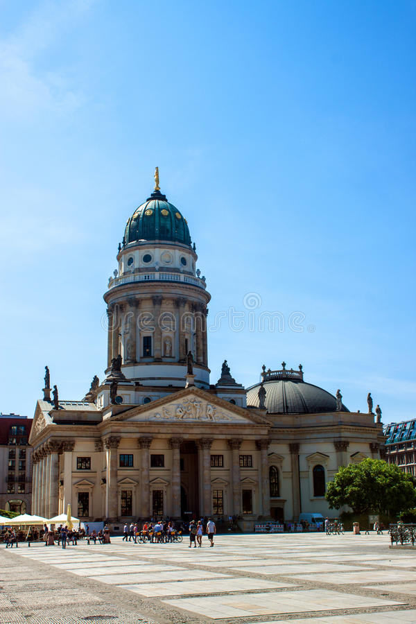 Franzosischer Dom in Berlin. BERLIN, GERMANY - JUNE 7: Franzosischer Dom and Church with admiring tourists at the Gendarmenmarkt in the center of the city on royalty free stock photography