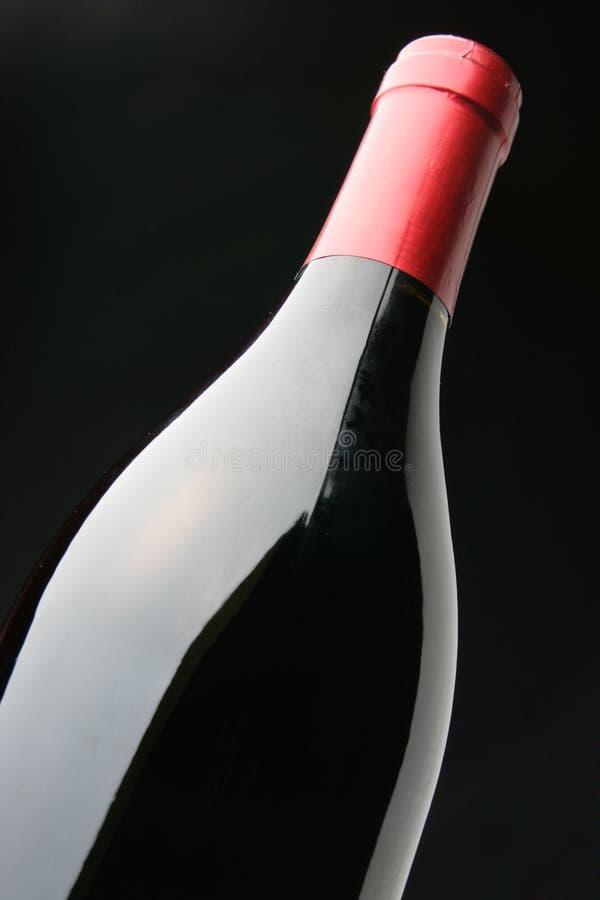Frasco arrolhado do vinho vermelho fotos de stock royalty free