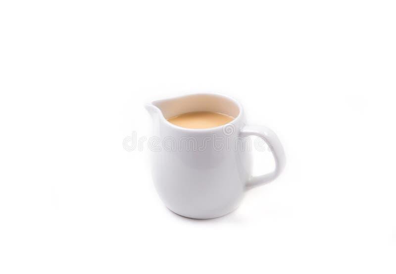 Frasco branco do leite condensado Sweetened imagens de stock royalty free