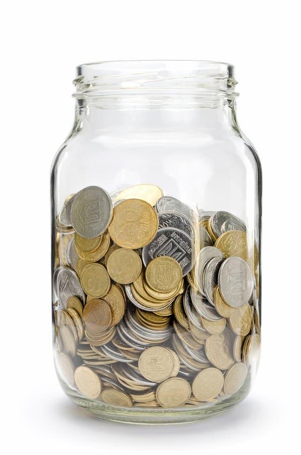 Frasco com moedas fotos de stock royalty free