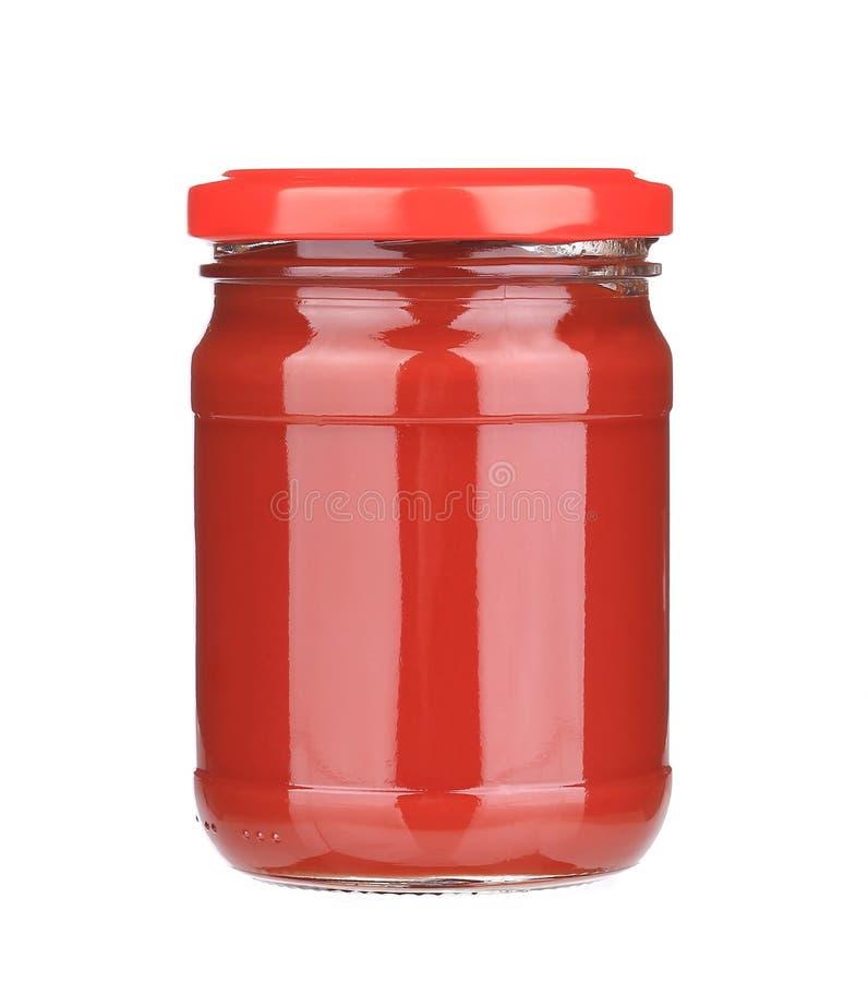 Frasco com pasta de tomate imagens de stock royalty free