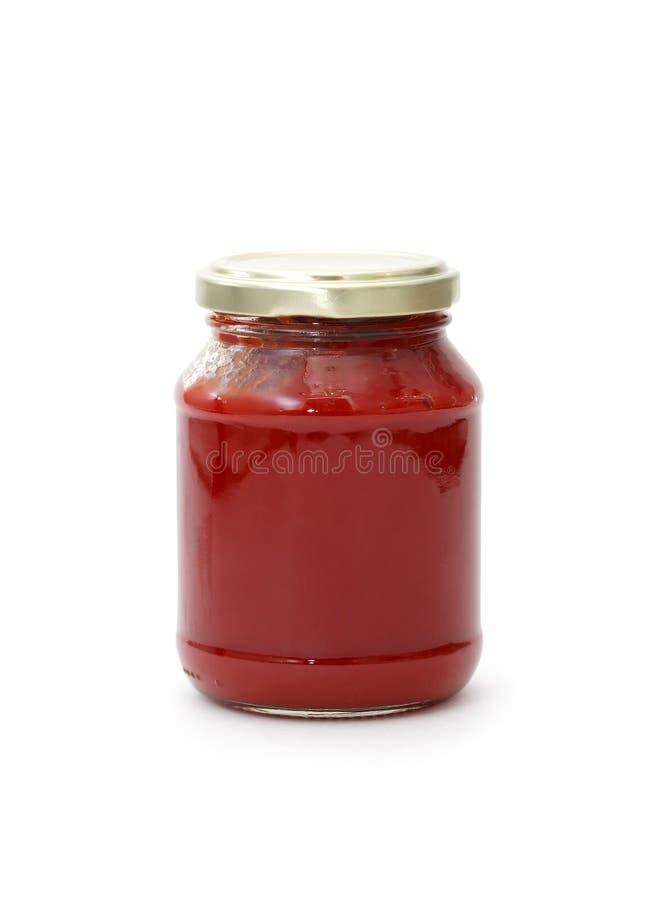Frasco com pasta de tomate foto de stock